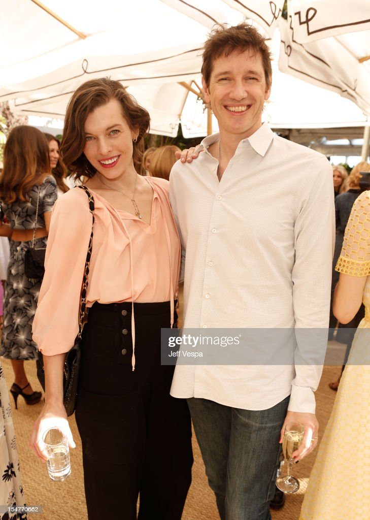 Actress <a gi-track='captionPersonalityLinkClicked' href=/galleries/search?phrase=Milla+Jovovich&family=editorial&specificpeople=202207 ng-click='$event.stopPropagation()'>Milla Jovovich</a> and director <a gi-track='captionPersonalityLinkClicked' href=/galleries/search?phrase=Paul+W.+S.+Anderson+-+English+Director&family=editorial&specificpeople=4516349 ng-click='$event.stopPropagation()'>Paul W. S. Anderson</a> attend CFDA/Vogue Fashion Fund Event hosted by Lisa Love and Mark Holgate and sponsored by Audi, Beauty.com, American Express, and J Brand at Chateau Marmont on October 25, 2012 in Los Angeles, California.