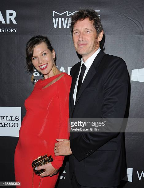 Actress Milla Jovovich and director Paul WS Anderson arrive at the 2014 amfAR LA Inspiration Gala at Milk Studios on October 29 2014 in Hollywood...