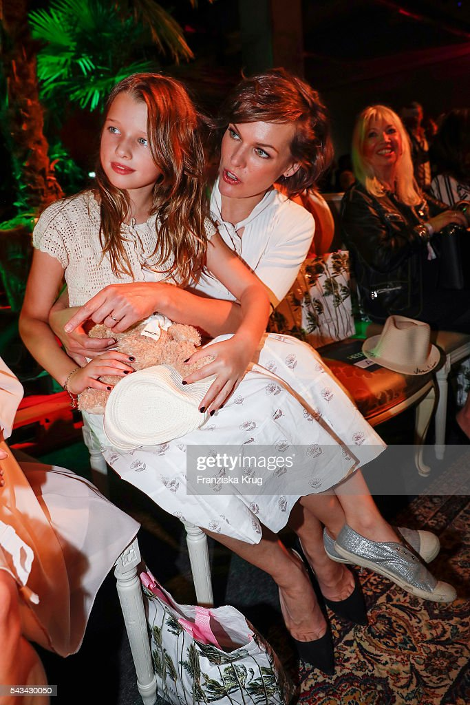 US actress Milla Jovovich and her daughter Ever Gabo attend the Marc Cain show Spring/Summer 2017 at CITY CUBE Panorama Bar on June 28, 2016 in Berlin, Germany.