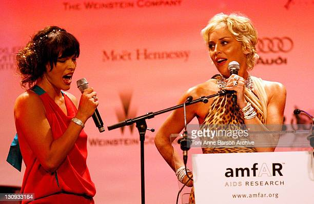 Actress Milla Jovovich and host Sharon Stone at amfAR's Cinema Against AIDS 2008 benefit held at Le Moulin de Mougins during the 61st International...