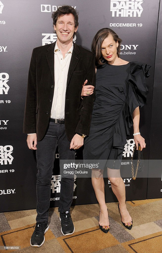 Actress Milla Jovovich (R) and husband/director Paul W.S. Anderson arrive at the Los Angeles premiere of 'Zero Dark Thirty' at the Dolby Theatre on December 10, 2012 in Hollywood, California.