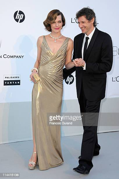 Actress Milla Jovovich and Paul Anderson attend amfAR's Cinema Against AIDS Gala during the 64th Annual Cannes Film Festival at Hotel Du Cap on May...