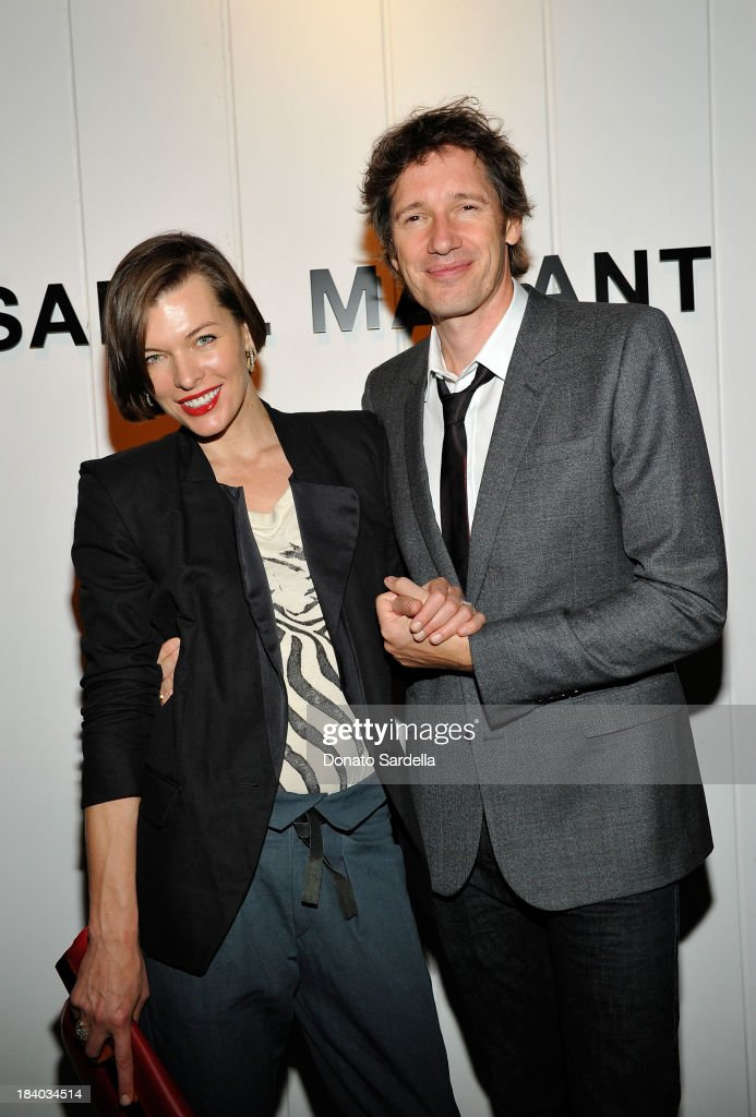 Actress <a gi-track='captionPersonalityLinkClicked' href=/galleries/search?phrase=Milla+Jovovich&family=editorial&specificpeople=202207 ng-click='$event.stopPropagation()'>Milla Jovovich</a> and <a gi-track='captionPersonalityLinkClicked' href=/galleries/search?phrase=Paul+W.+S.+Anderson+-+English+Director&family=editorial&specificpeople=4516349 ng-click='$event.stopPropagation()'>Paul W. S. Anderson</a> attend Isabel Marant & <a gi-track='captionPersonalityLinkClicked' href=/galleries/search?phrase=Milla+Jovovich&family=editorial&specificpeople=202207 ng-click='$event.stopPropagation()'>Milla Jovovich</a> BBQ party to celebrate the 1st Year of he LA Shop at Isabel Marant on October 10, 2013 in Los Angeles, California.