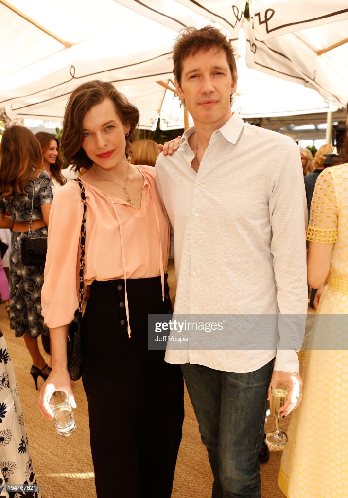 Actress Milla Jovovich and Paul W. S. Anderson attends CFDA/Vogue Fashion Fund Event hosted by Lisa Love and Mark Holgate and sponsored by Audi, Beauty.com, American Express, and J Brand at Chateau Marmont on October 25, 2012 in Los Angeles, California.