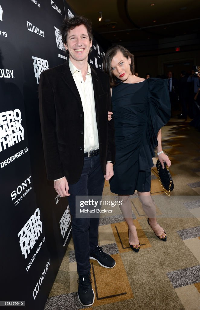 Actress Milla Jovovich (R) and Paul W. S.Anderson arrive at the Los Angeles premiere of Columbia Pictures' 'Zero Dark Thirty' at Dolby Theatre on December 10, 2012 in Hollywood, California.