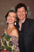 Actress Milla Jovovich and Paul WS Anderson attend the Marni at HM Collection Launch at Lloyd Wright's Sowden House on February 17 2012 in Los...