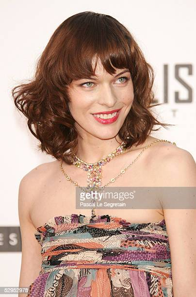 Actress Milla Jovovich arrives at 'Cinema Against AIDS 2005' the 12th annual event in aid of amfAR at Le Moulin de Mougins at the 58th Cannes Film...