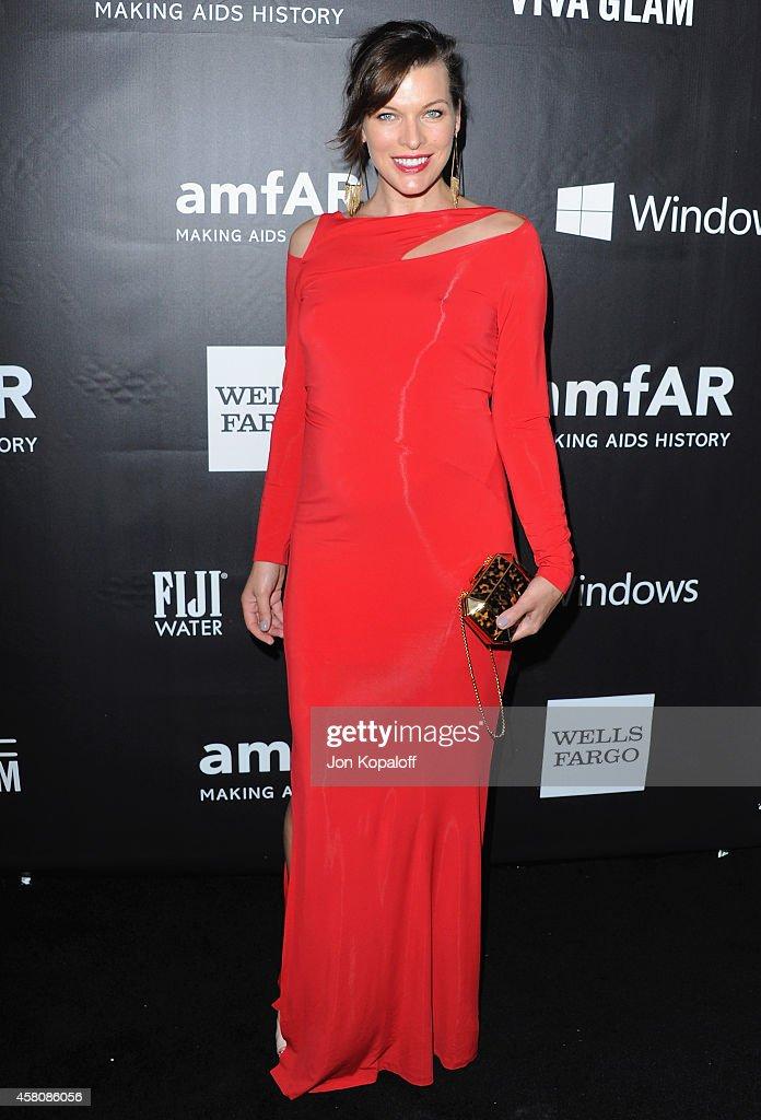 Actress Milla Jovovich arrives at the 2014 amfAR LA Inspiration Gala at Milk Studios on October 29 2014 in Hollywood California