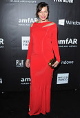 Actress Milla Jovovich arrives at the 2014 amfAR LA Inspiration Gala at Milk Studios on October 29 2014 in Hollywood California