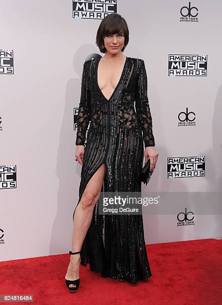 Actress Milla Jovovich arrives at the 2016 American Music Awards at Microsoft Theater on November 20 2016 in Los Angeles California