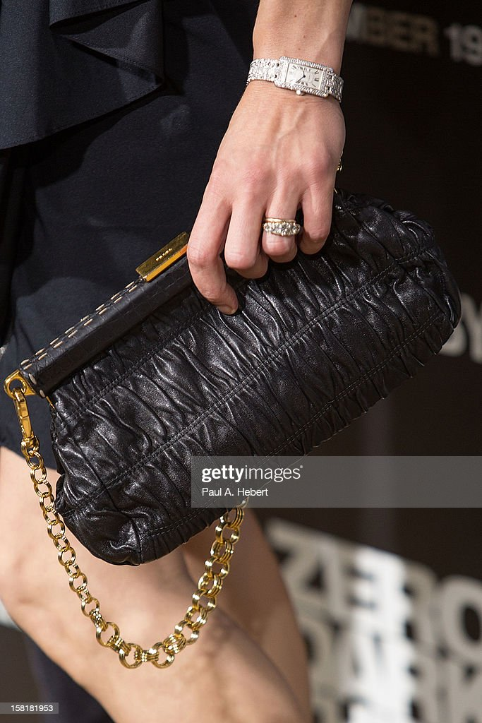 Actress Milla Jovovich (clutch detail) arrives at the premiere of Columbia Pictures' 'Zero Dark Thirty' held at the Dolby Theatre on December 10, 2012 in Hollywood, California.