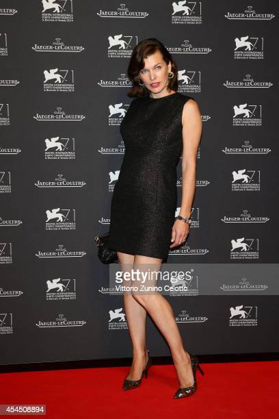 Actress Milla Jovovich arrives wearing a JaegerLeCoultre watch for a gala dinner hosted by JaegerLeCoultre at Scuola Grande di San Rocco during the...