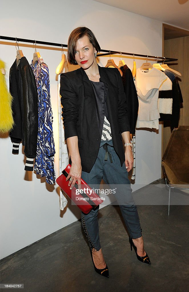 Actress <a gi-track='captionPersonalityLinkClicked' href=/galleries/search?phrase=Milla+Jovovich&family=editorial&specificpeople=202207 ng-click='$event.stopPropagation()'>Milla Jovovich</a> attend Isabel Marant & <a gi-track='captionPersonalityLinkClicked' href=/galleries/search?phrase=Milla+Jovovich&family=editorial&specificpeople=202207 ng-click='$event.stopPropagation()'>Milla Jovovich</a> BBQ party to celebrate the 1st Year of he LA Shop at Isabel Marant on October 10, 2013 in Los Angeles, California.