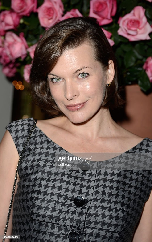 Actress <a gi-track='captionPersonalityLinkClicked' href=/galleries/search?phrase=Milla+Jovovich&family=editorial&specificpeople=202207 ng-click='$event.stopPropagation()'>Milla Jovovich</a> attends the 2014 CFDA/Vogue Fashion Fund Event presented by thecorner.com and supported by Aveda, Lexus, and Maybelline New York at Chateau Marmont on October 21, 2014 in Los Angeles, California.