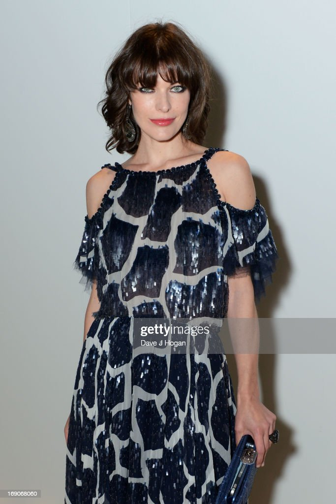 Actress <a gi-track='captionPersonalityLinkClicked' href=/galleries/search?phrase=Milla+Jovovich&family=editorial&specificpeople=202207 ng-click='$event.stopPropagation()'>Milla Jovovich</a> attends the Vanity Fair and Chanel dinner during The 66th Annual Cannes Film Festival at Tetou Restaurant on May 19, 2013 in Cannes, France.