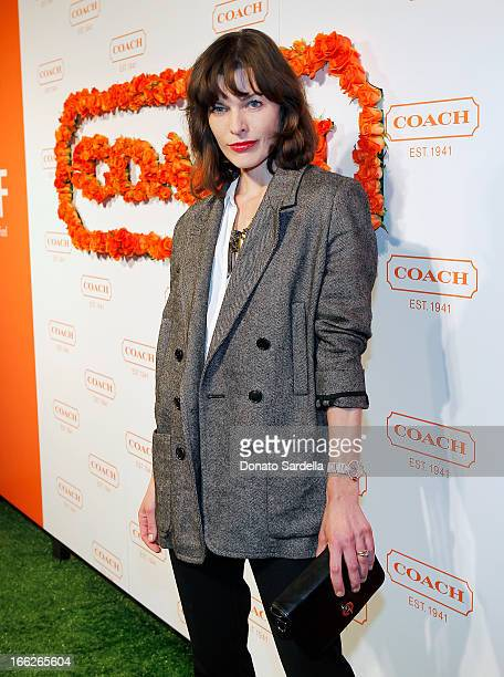Actress Milla Jovovich carrying Coach attends Coach's 3rd Annual Evening of Cocktails and Shopping to Benefit the Children's Defense Fund hosted by...