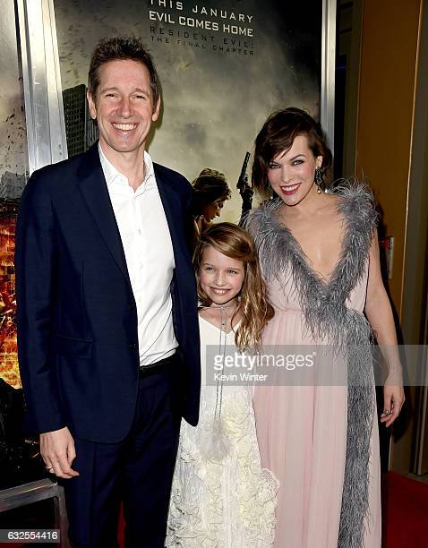 Actress Milla Jovovich her husband writer/director Paul WS Anderson and their daughter actress Ever Gabo Anderson arrive at the premiere of Sony...