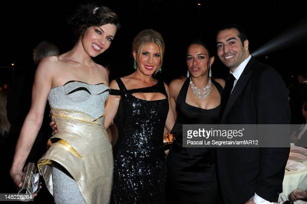 Actress Milla Jovovich Hofit Golan Michelle Rodriguez and Mohammed Al Turki attend the 2012 amfAR's Cinema Against AIDS during the 65th Annual Cannes...