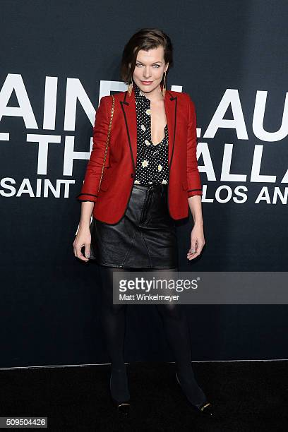 Actress Milla Jovovich in Saint Laurent by Hedi Slimane arrives at the Saint Laurent show at the Hollywood Palladium on February 10 2016 in Los...