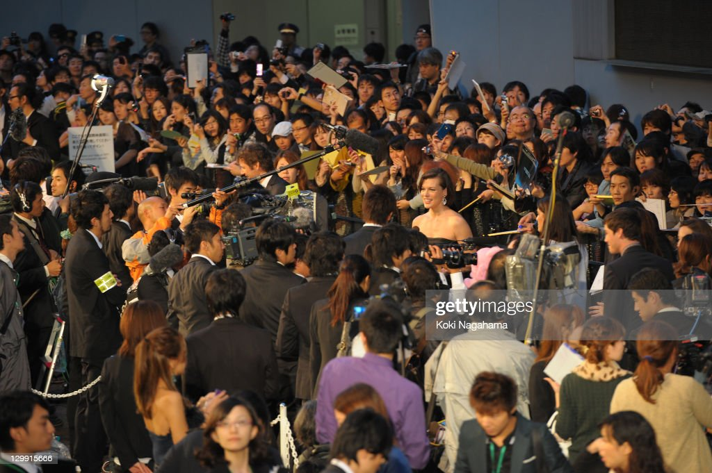 Actress Milla Jovovich is inteviewed on the green carpet during the Tokyo International Film Festival Opening Ceremony at Roppongi Hills on October 22, 2011 in Tokyo, Japan.