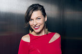 Actress Milla Jovovich poses for a portrait at the amfAR LA Inspiration Gala on October 29 2014 in Los Angeles California