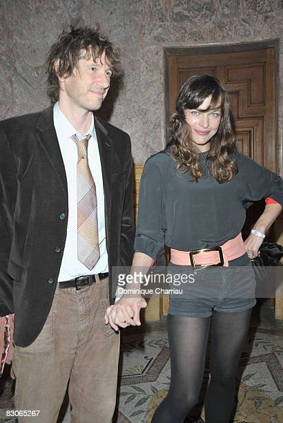 Actress Milla Jovovich poses with director Paul WS Anderson as she attends the Patrick Demarchelier's exhibition Party on September 29 2008 in Paris...