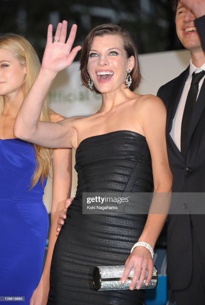 Actress Milla Jovovich waves on the green carpet during the Tokyo International Film Festival Opening Ceremony at Roppongi Hills on October 22, 2011 in Tokyo, Japan.