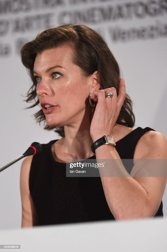 Actress Milla Jovovich wearing a Jaeger-LeCoultre Reverso watch attends the 'Cymbeline' press conference before the photocall during the 71st Venice Film Festival at the Palazzo del Casino on September 3, 2014 in Venice, Italy.