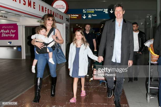 Actress Milla Jovovitch her daughters Dashiel Edan Anderson and Ever Gabo Anderson and her husband Paul WS Anderson arrive at CharlesdeGaulle airport...