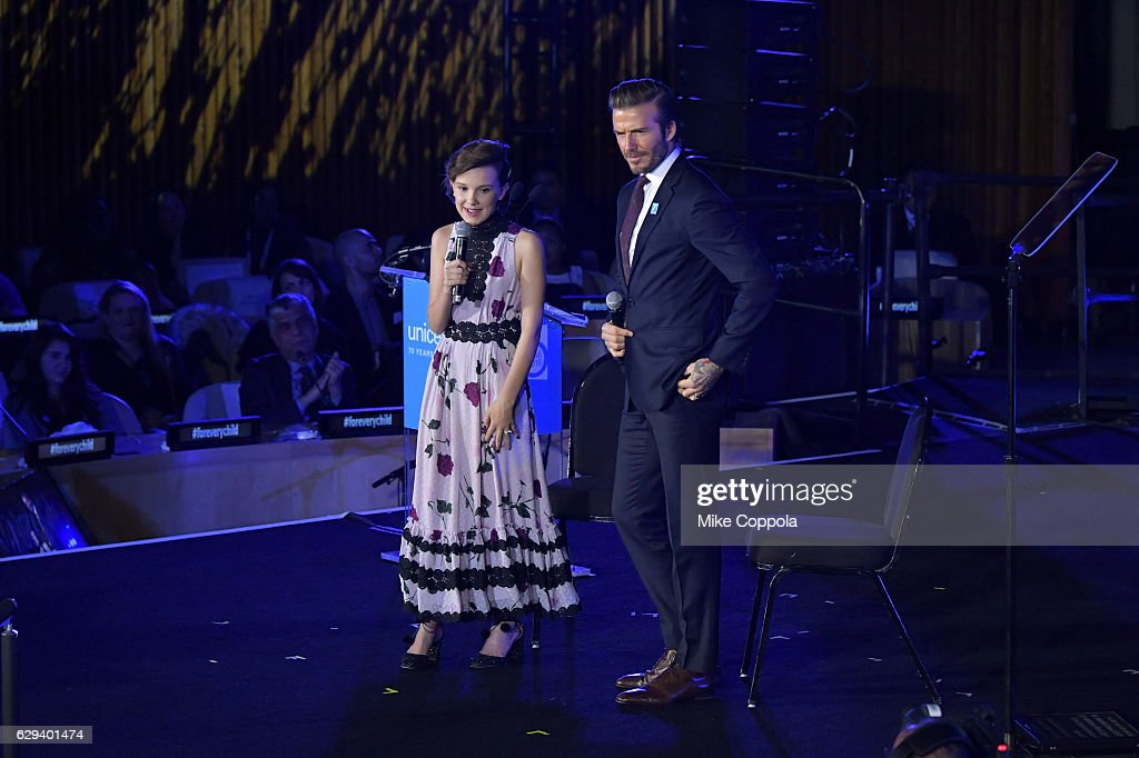 Actress Millie Bobby Brown and UNICEF Goodwill Ambassador David Beckham speak on stage during UNICEF's 70th Anniversary Event at United Nations Headquarters on December 12, 2016 in New York City.