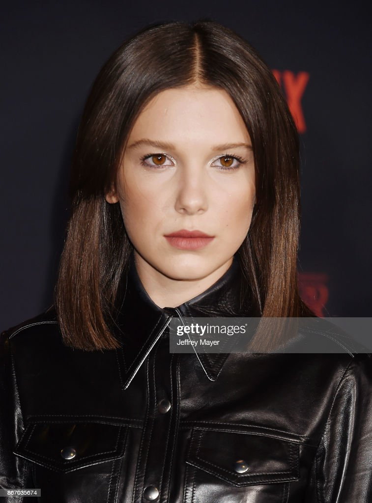 Actress Millie Bobby Brown arrives at the Premiere Of Netflix's 'Stranger Things' Season 2 at Regency Westwood Village Theatre on October 26, 2017 in Los Angeles, California.