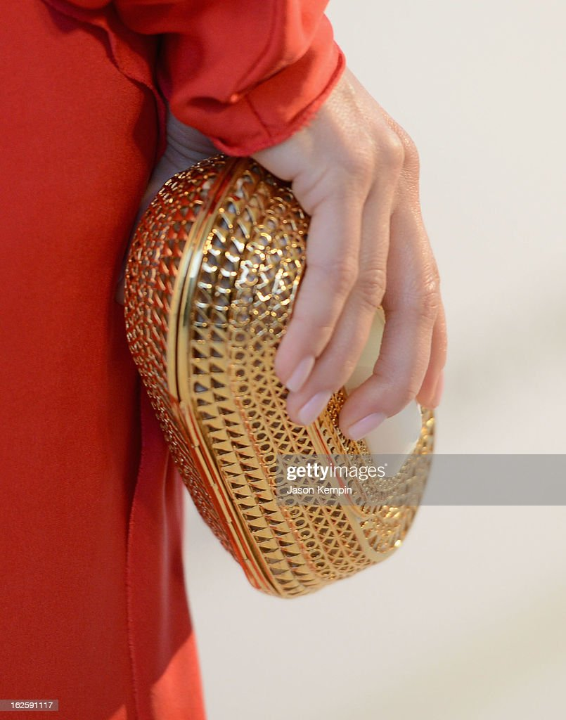 Actress Mina Suvari (handbag detail) attends the 21st Annual Elton John AIDS Foundation Academy Awards Viewing Party at West Hollywood Park on February 24, 2013 in West Hollywood, California.