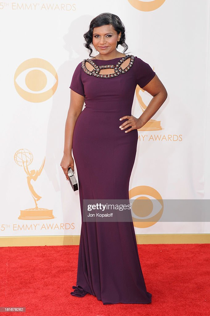 Actress <a gi-track='captionPersonalityLinkClicked' href=/galleries/search?phrase=Mindy+Kaling&family=editorial&specificpeople=743884 ng-click='$event.stopPropagation()'>Mindy Kaling</a> arrives at the 65th Annual Primetime Emmy Awards at Nokia Theatre L.A. Live on September 22, 2013 in Los Angeles, California.