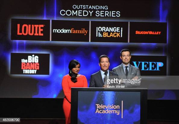 Actress Mindy Kaling Television Academy Chairman CEO Bruce Rosenblum and tv personality Carson Daly speak onstage at the 66th Primetime Emmy Awards...