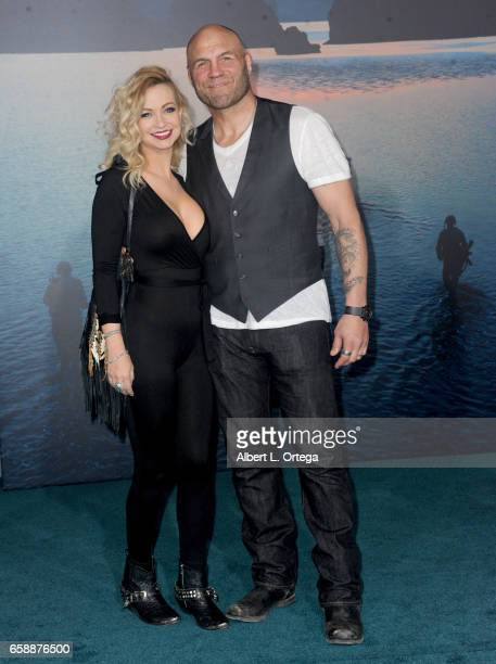 Actress Mindy Robinson and actor/fighter Randy Couture arrive for the Premiere Of Warner Bros Pictures' 'Kong Skull Island' held at Dolby Theatre on...