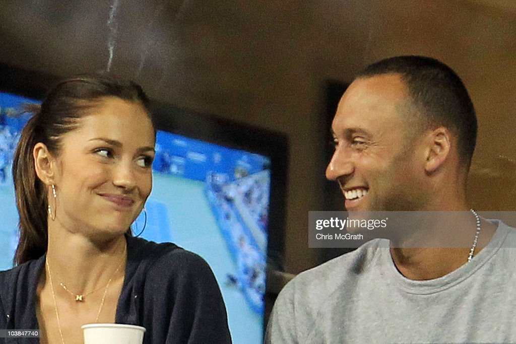 Actress Minka Kelly and Derek Jeter of the New York Yanklees watch as Novak Djokovic of Serbia plays against James Blake of the United States during...