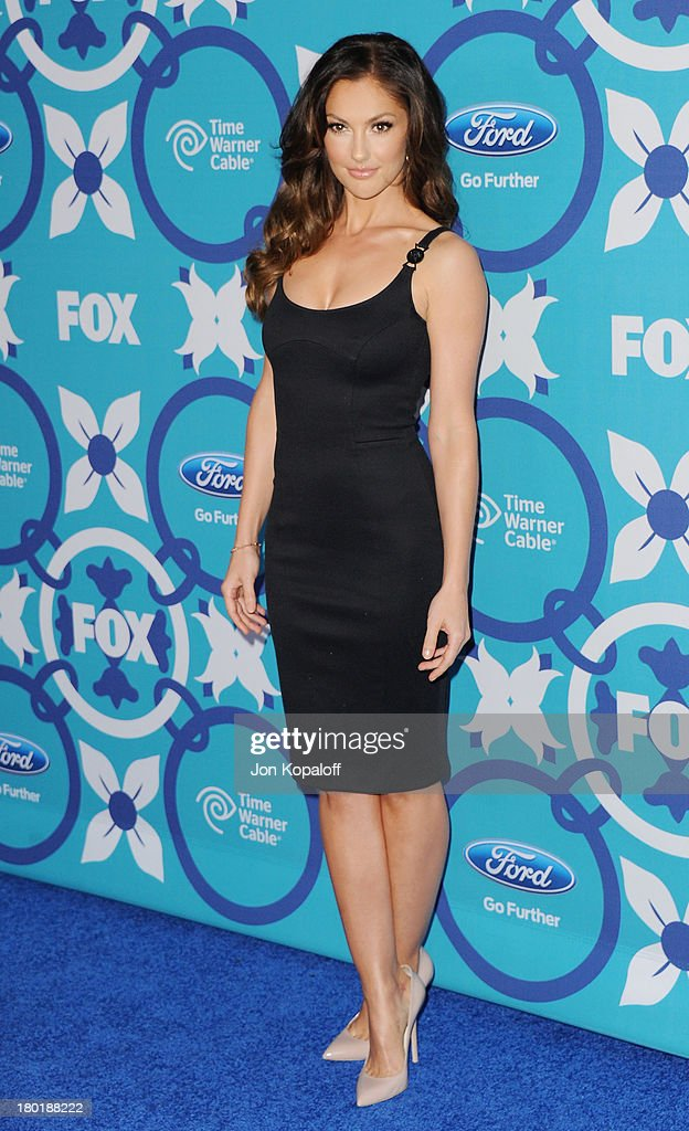 Actress Minka Kelly arrives at the 2013 Fox Fall Eco-Casino Party at The Bungalow on September 9, 2013 in Santa Monica, California.