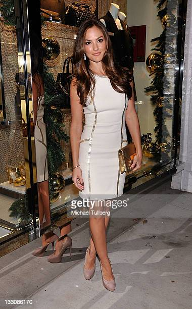 Actress Minka Kelly arrives at the opening of the new Michael Kors lifestyle store on Robertson Boulevard on November 16 2011 in Los Angeles...
