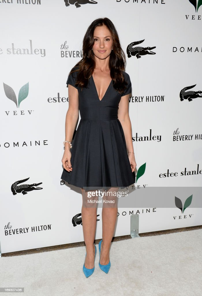 Actress <a gi-track='captionPersonalityLinkClicked' href=/galleries/search?phrase=Minka+Kelly&family=editorial&specificpeople=632847 ng-click='$event.stopPropagation()'>Minka Kelly</a> attends The Beverly Hilton unveiling of the redesigned Aqua Star Pool By Estee Stanley at The Beverly Hilton Hotel on May 22, 2013 in Beverly Hills, California.