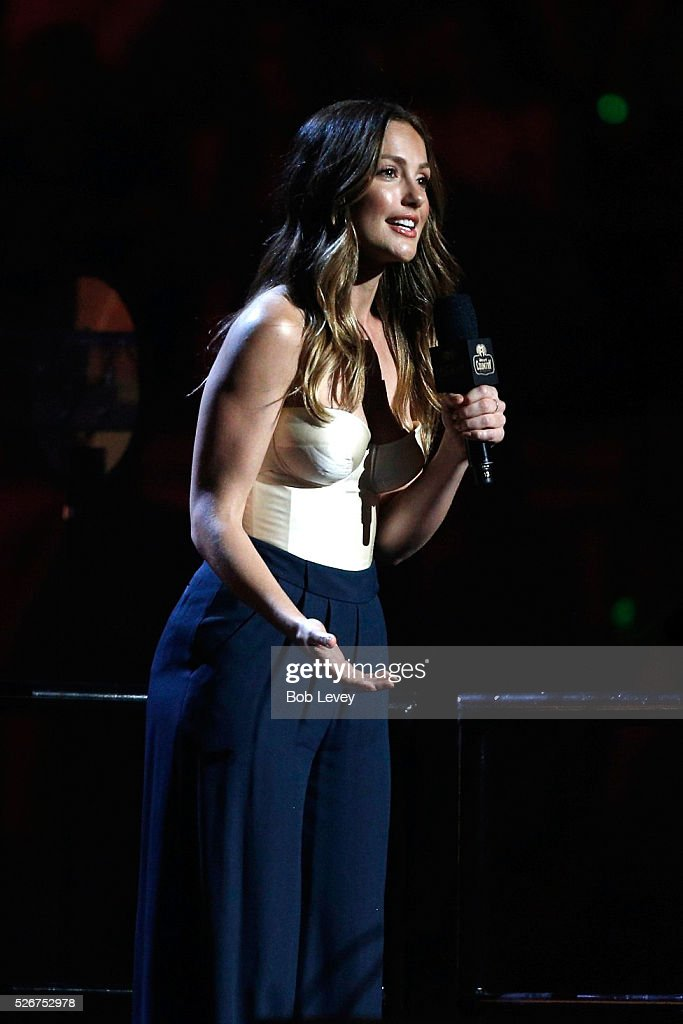Actress Minka Kelly speaks onstage during the 2016 iHeartCountry Festival at The Frank Erwin Center on April 30, 2016 in Austin, Texas.