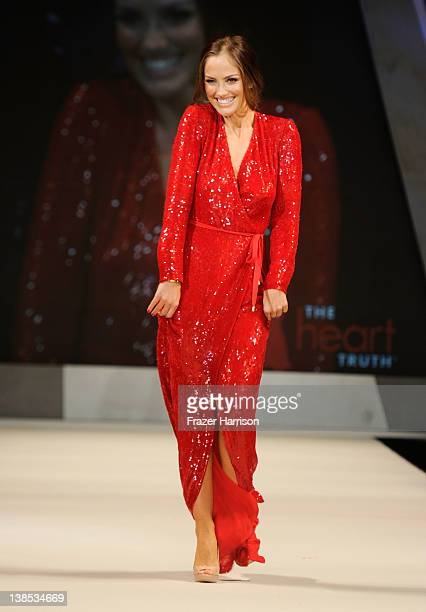 Actress Minka Kelly walks on the runway wearing a Diane von Furstenberg design at The Heart Truth's Red Dress Collection 2012 Fashion Show at...