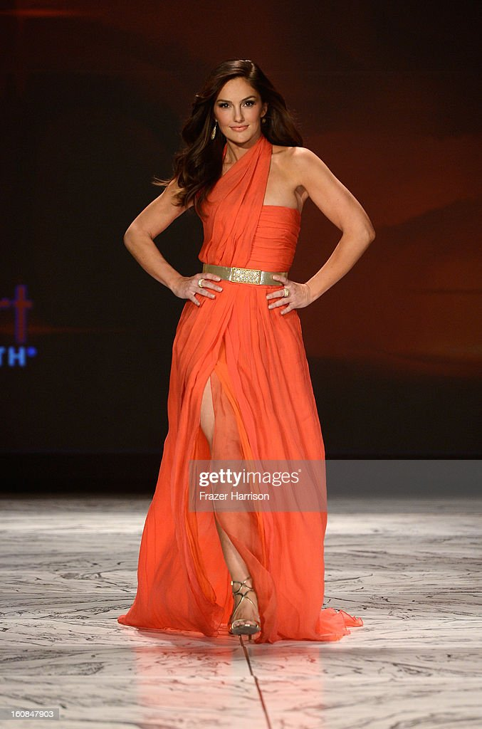 Actress Minka Kelly walks the runway at The Heart Truth 2013 Fashion Show at Hammerstein Ballroom on February 6, 2013 in New York City.