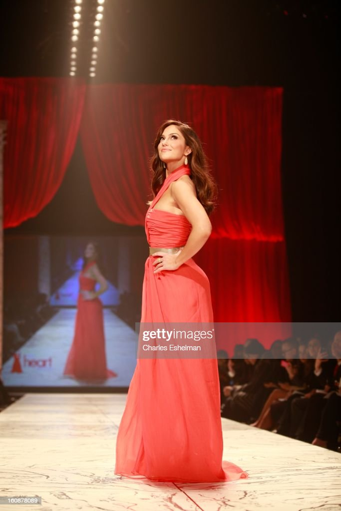 Actress Minka Kelly walks the runway The Heart Truth's Red Dress Collection Fall 2013 Mercedes-Benz Fashion Show at 499 Seventh Avenue on February 6, 2013 in New York City.