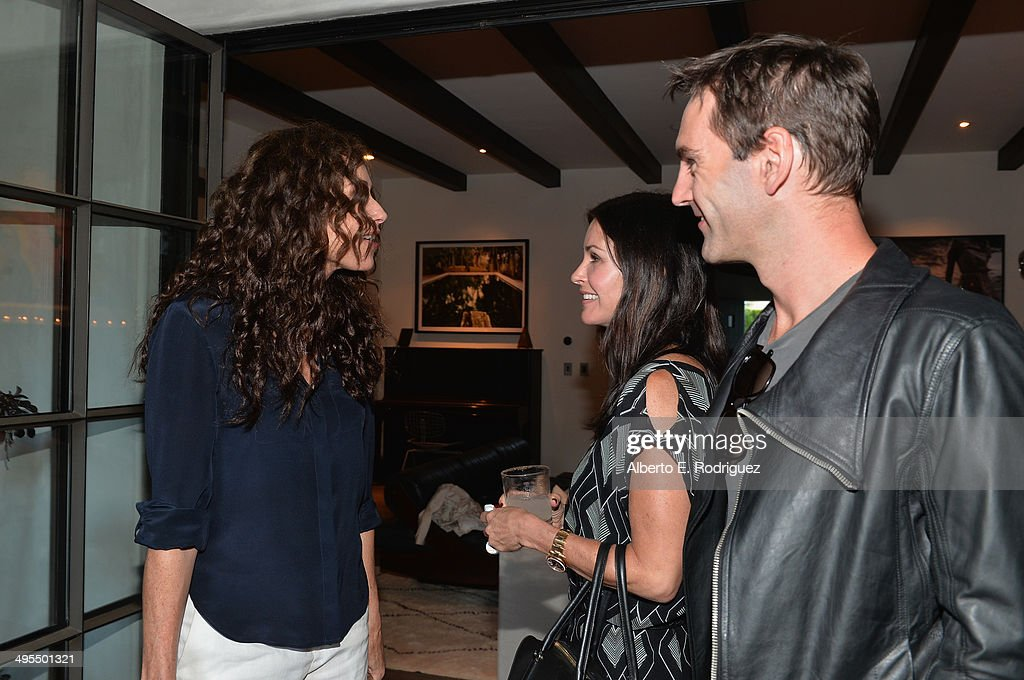 Actress <a gi-track='captionPersonalityLinkClicked' href=/galleries/search?phrase=Minnie+Driver&family=editorial&specificpeople=201884 ng-click='$event.stopPropagation()'>Minnie Driver</a>, actress <a gi-track='captionPersonalityLinkClicked' href=/galleries/search?phrase=Courteney+Cox&family=editorial&specificpeople=203101 ng-click='$event.stopPropagation()'>Courteney Cox</a> and songwrtier Johnny McDaid attend Kevin Morris' 'White Man's Problem' book release party on June 3, 2014 in Los Angeles, California.
