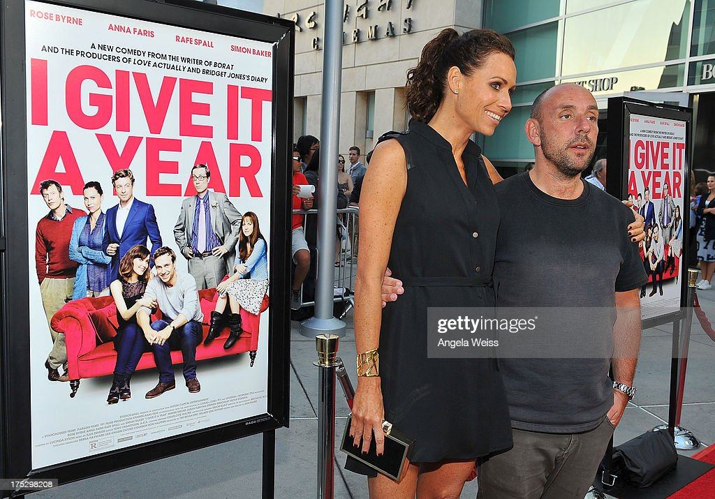 Actress Minnie Driver (L) and director Dan Mazer arrive at the Screening of Magnolia Pictures' 'I Give It A Year' at ArcLight Hollywood on August 1, 2013 in Hollywood, California.