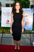 Actress Minnie Driver arrives at the Premiere of Lifetime Television's 'Return To Zero' at Paramount Theater on the Paramount Studios lot on May 1...