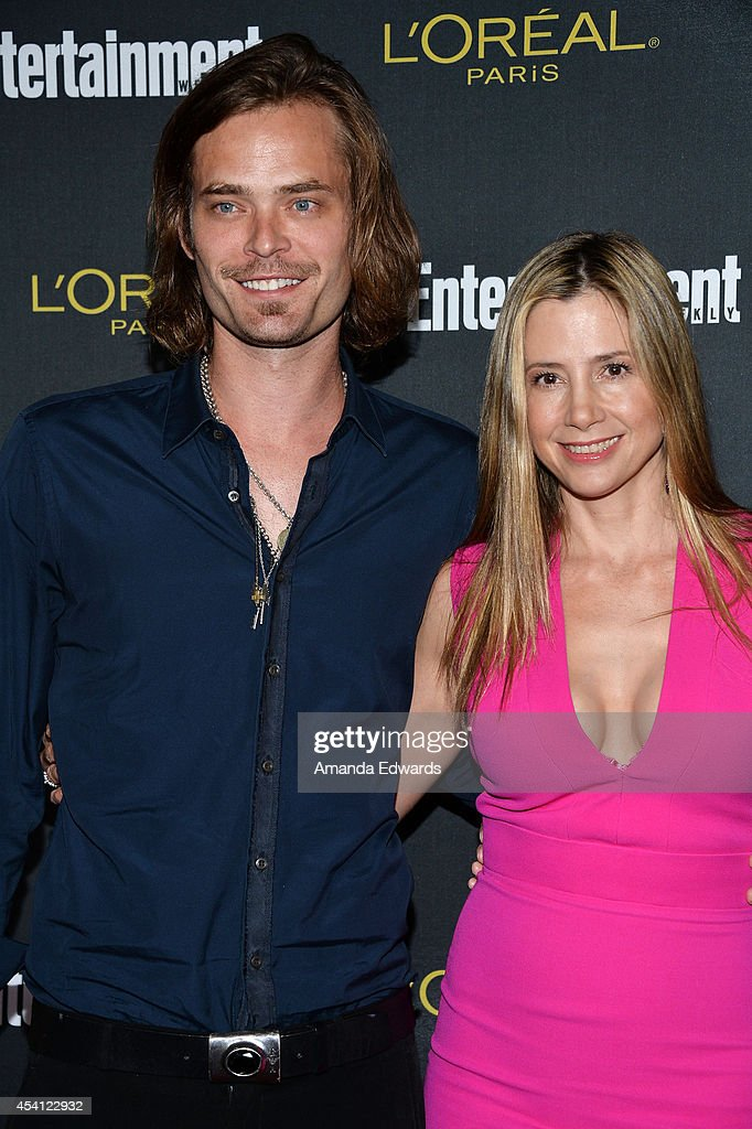 Actress Mira Sorvino (R) and her husband Christopher Backus arrive at the 2014 Entertainment Weekly Pre-Emmy Party at Fig & Olive Melrose Place on August 23, 2014 in West Hollywood, California.