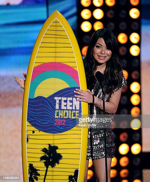 Actress Miranda Cosgrove accepts the Choice TV Comedy Actress award onstage during the 2012 Teen Choice Awards at Gibson Amphitheatre on July 22 2012...