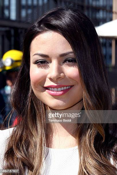 Actress Miranda Cosgrove attends the Despicable Me Minion Mayhem and Super Silly Fun Land open at Universal Studios Hollywood on April 11 2014 in...