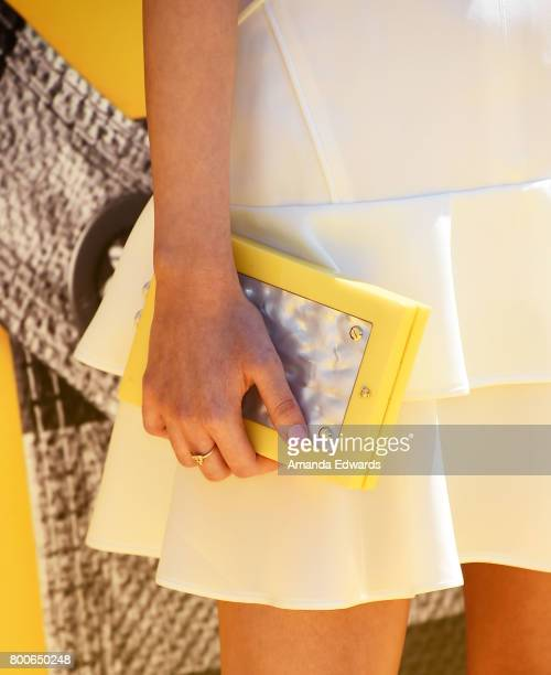 Actress Miranda Cosgrove clutch detail arrives at the premiere of Universal Pictures and Illumination Entertainment's 'Despicable Me 3' at The Shrine...